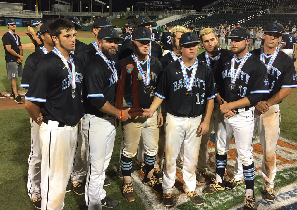 Head+coach+Matt+Cleveland+and+the+eleven+seniors+on+the+varsity+baseball+team+pose+with+the+state+runner-up+trophy.+They+were+defeated+by+Lincoln%2C+5-1.