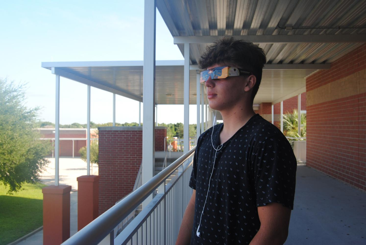 Freshman Hunter Soto prepares for the viewing of the solar eclipse.  One of the safe ways to look at the eclipse is to use NASA approved eclipse glasses.