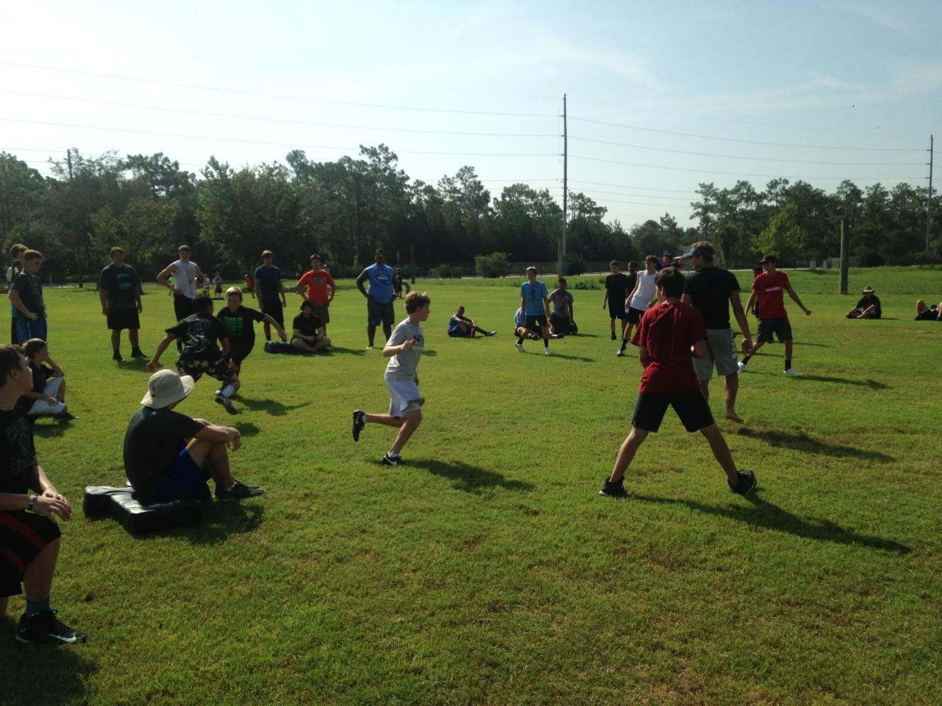 Campers+play+tag+to+practice+tracking+the+ball+carrier.+74+kids+attended+the+camp.