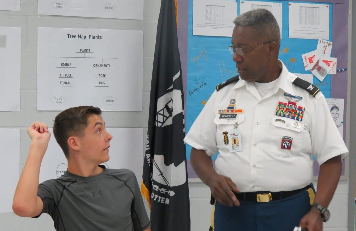 Col. Wimbish answers sophomore Ian Dauber's question about the curriculum. Asking questions in JROTC is highly encouraged,