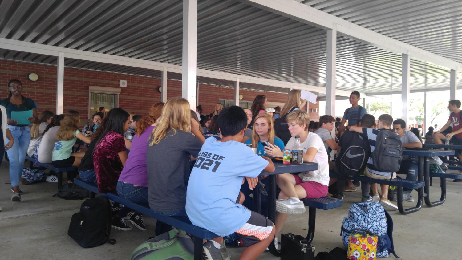 Students eat at the tables outside of the cafeteria, the only outside area where students are allowed to eat this year.