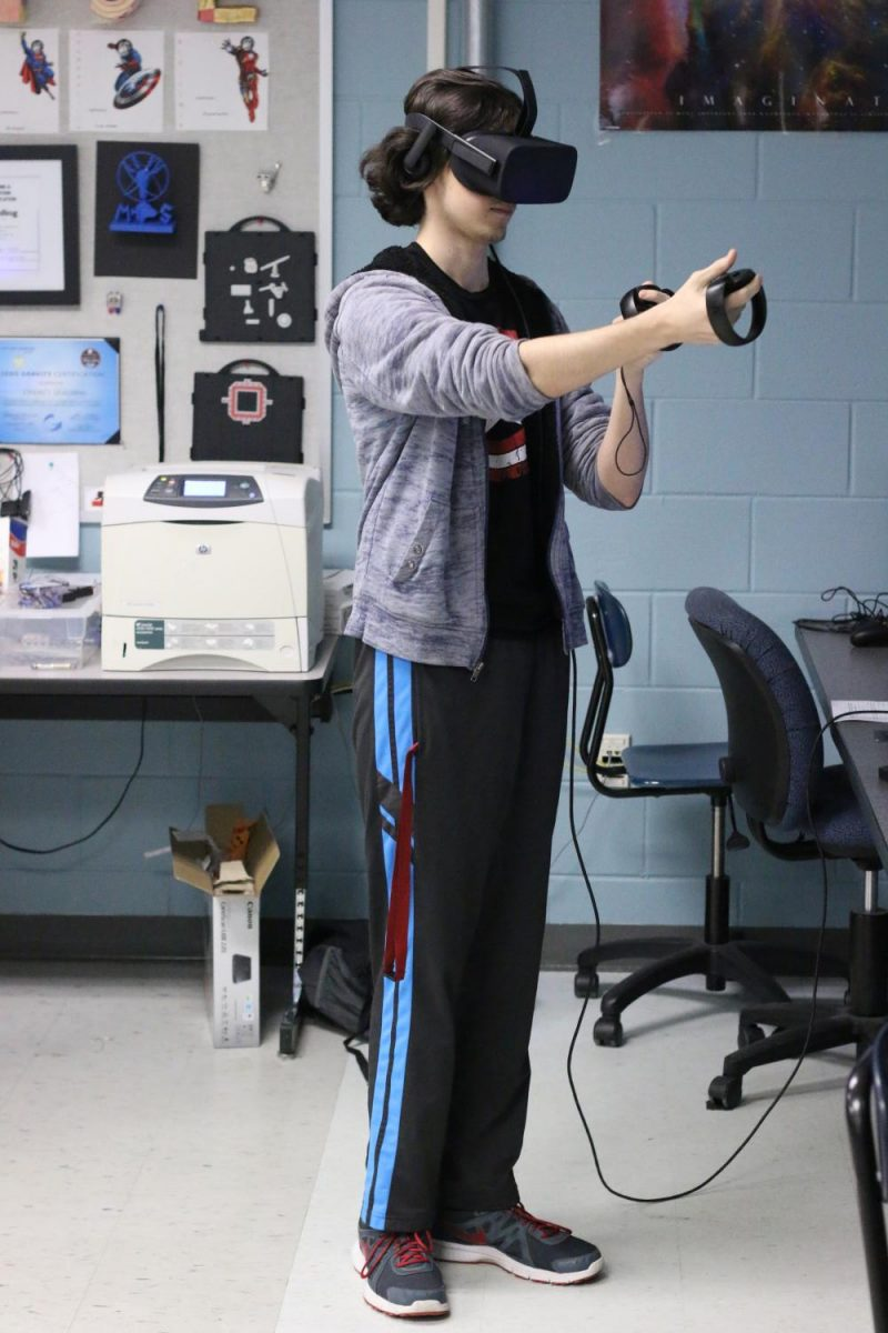 Senior Samuel Lee practices using the virtual reality lab. Many Modeling and Simulation projects, including the SWAT simulation, are created with the use of the VR lab.