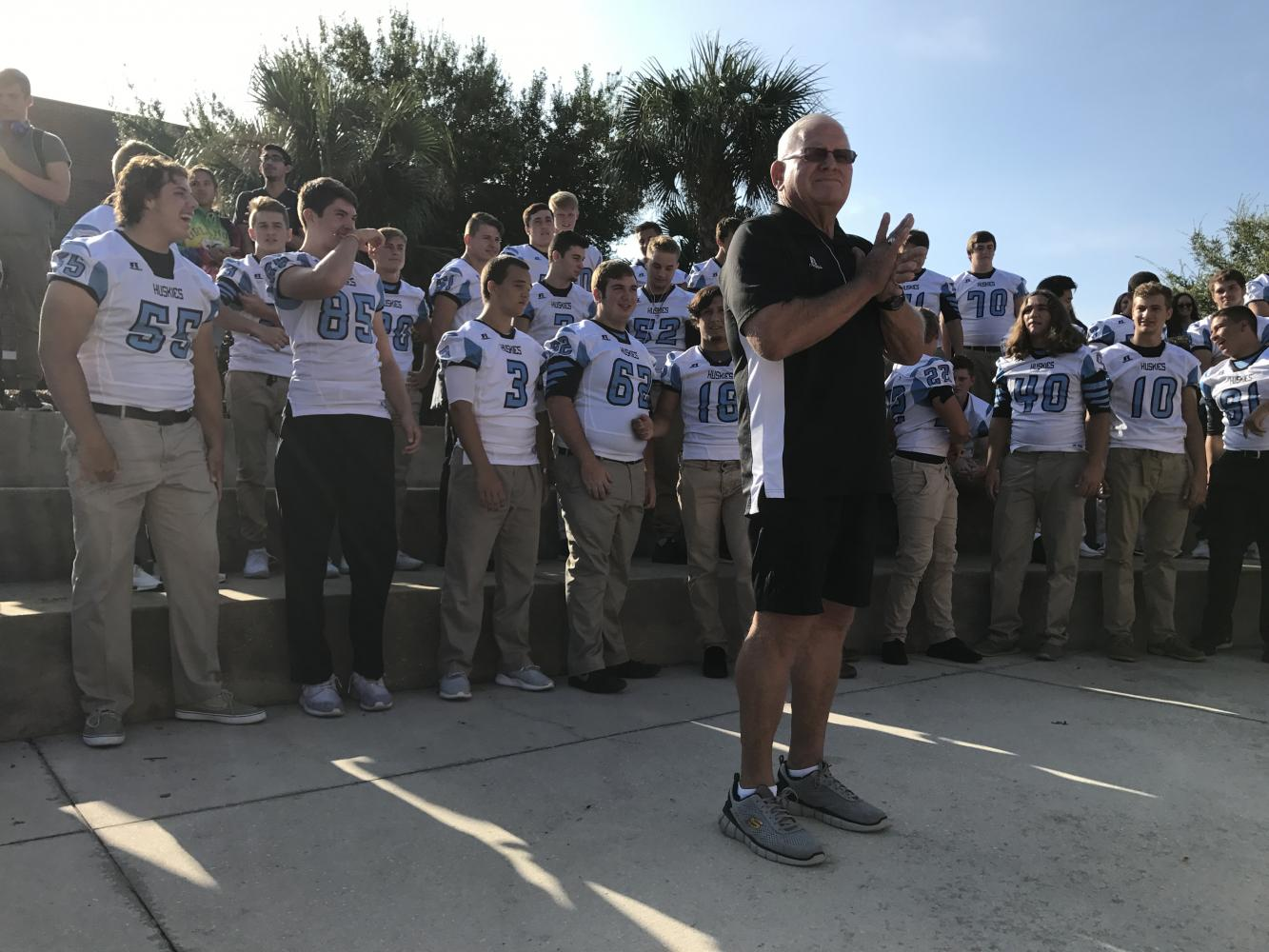 Head coach Phil Ziglar stands with the football team in the amphitheater during the mini-pep rally. They take on Oviedo Thursday at 7 p.m.