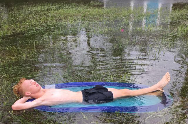 Junior Jack Chitty relaxes in the flood at his dad's house caused by Hurricane Irma. The flooding did not reach the house or cause any damage.
