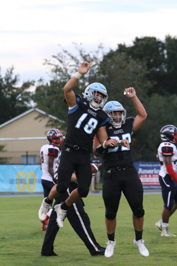 Running back Oliver Hart celebrates a touchdown against Lake Brantley in the first game of the season, a 22-12 win.