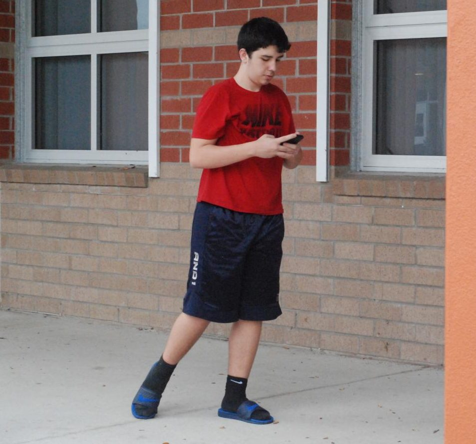Sophomore Joshua Nushworsh steps on a crack on his way to class. He does not have any superstitions when it comes to walking.