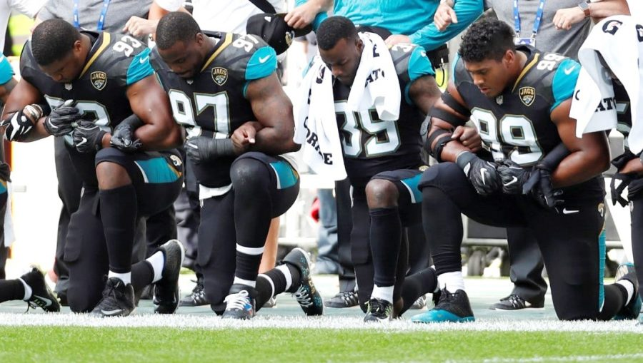 Jacksonville Jaguars Calais Campbell (93), Malik Jackson (97), Tashaun Gipson (39) and Eli Ankou (99) kneel during the playing of the U.S. national anthem before a game against the Baltimore Ravens in London on Sept. 24.
