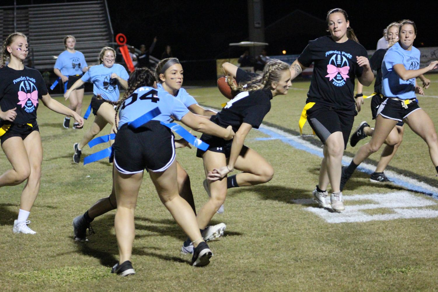 Senior Rachel Robbins fights through the crowd. She scored two touchdowns during the game.
