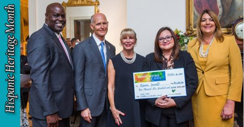 Science teacher Romina Jannotti poses with Gov. Rick Scott and First Lady Anne Scott. Jannotti won the Excellence in Education Award for high school teachers across Florida.