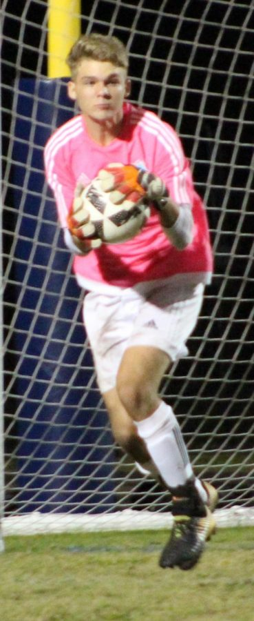 Goalie Daniel Dearolph fields the ball during a match against Oviedo. He earned seven saves during the team's 3-1 victory.