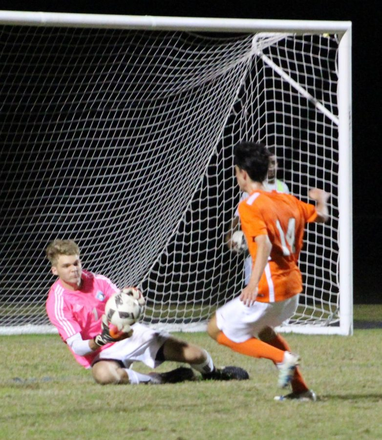 Goalie Daniel Dearolph saves a potential goal against Oviedo. He would get seven of them during the 3-1 win.