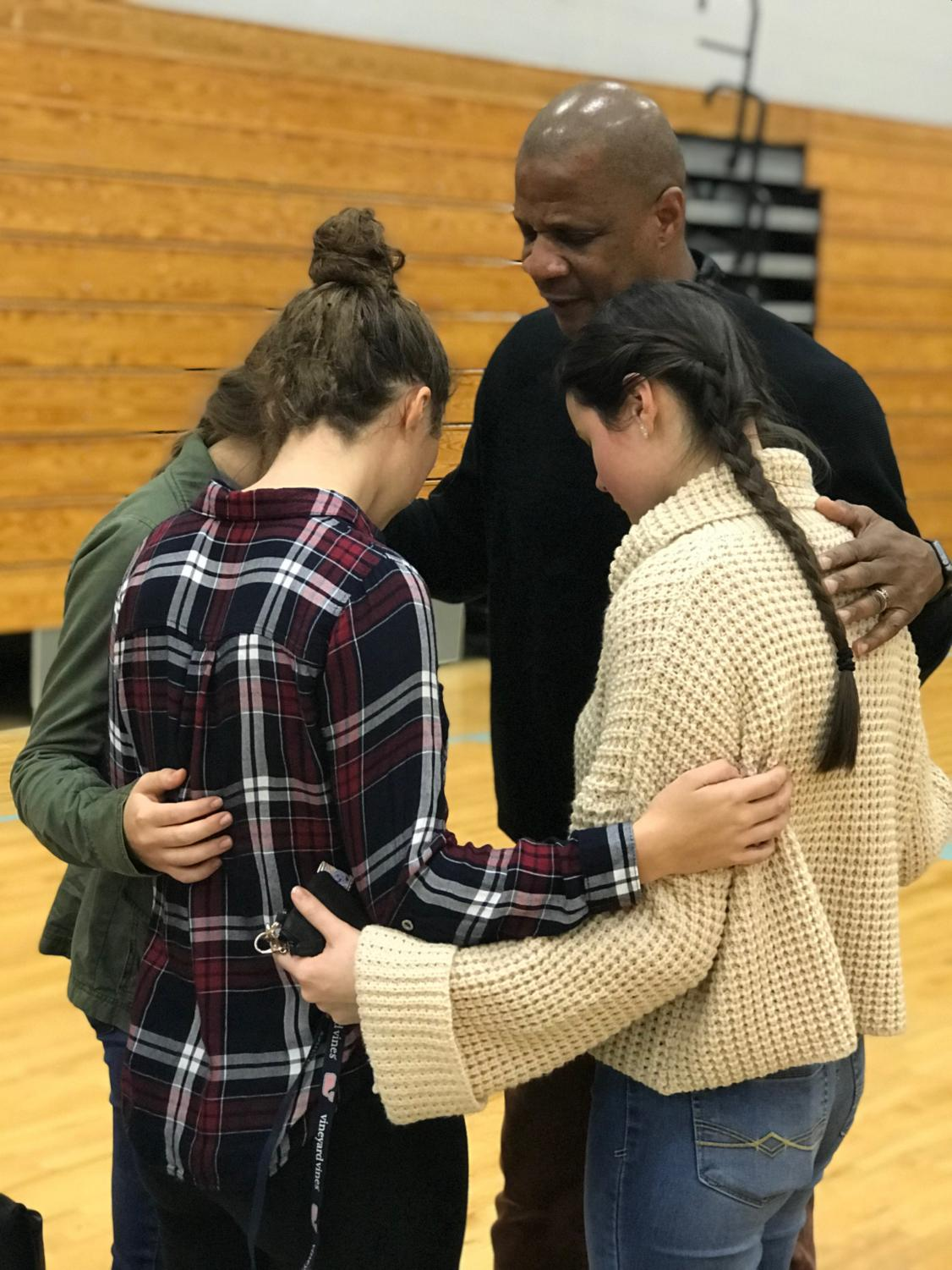 Darryl Strawberry and club members pray after the ceremony. Members who attended got to listen to Strawberry's presentation as well as has individual time with him.