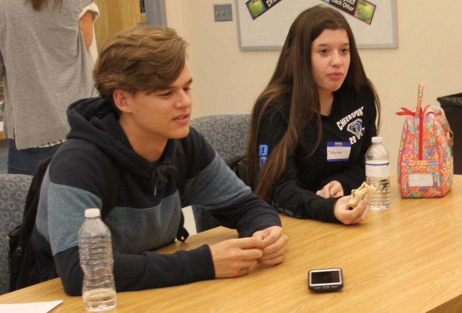 Junior Cooper Kirk and student ambassador Madyson Johnson converse with other students attending the 'Sit with Us' lunch.