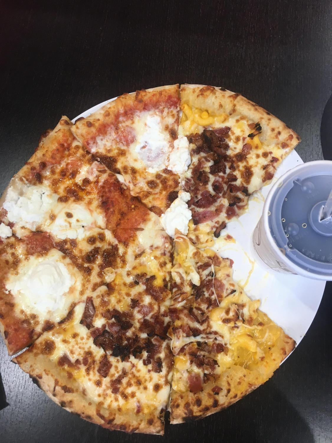Half cheese, half bacon mac and cheese pizza with a side of coke from 1000 Degrees,  located on Mitchell Hammock.