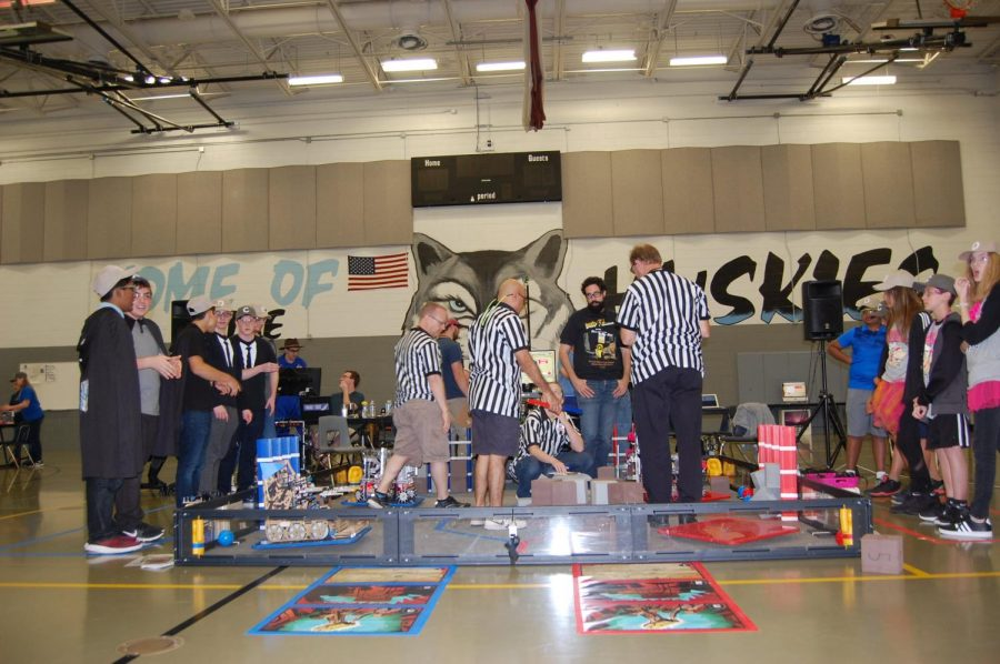 Team 4717, the Mechromancers, compete with other robotic teams. The Pink team (on the right) are from Brevard County.