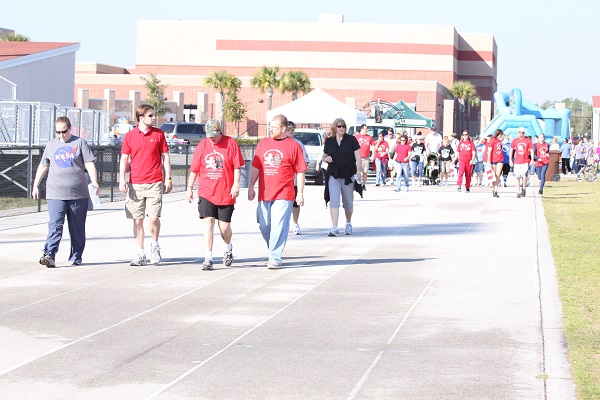 Participants walk around the track at the Sam Momary Stadium. Last year, this event was able to raise over $4,000.