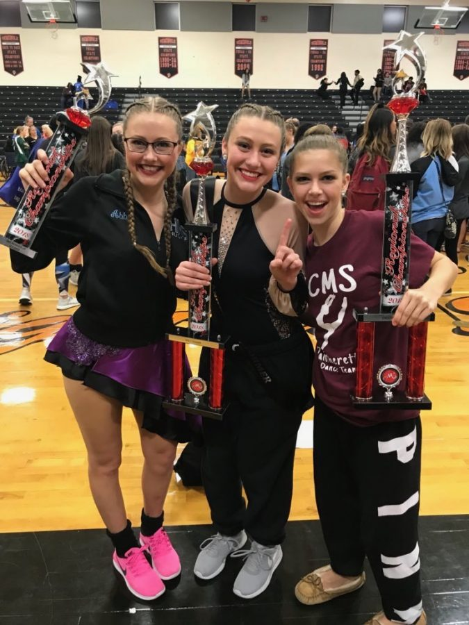 Senior Abby Smith poses with her sisters at a dance competition. Their trio won first place.
