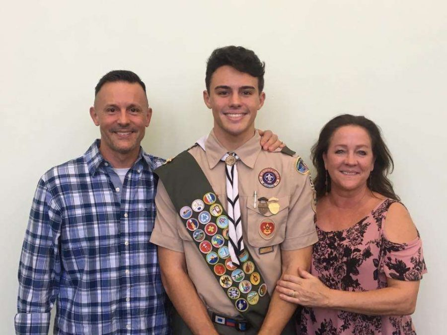 Senior Jacob Strickle poses with his parents, Jeff and Jodi Strickle. This was after being awarded the Eagle Scout.