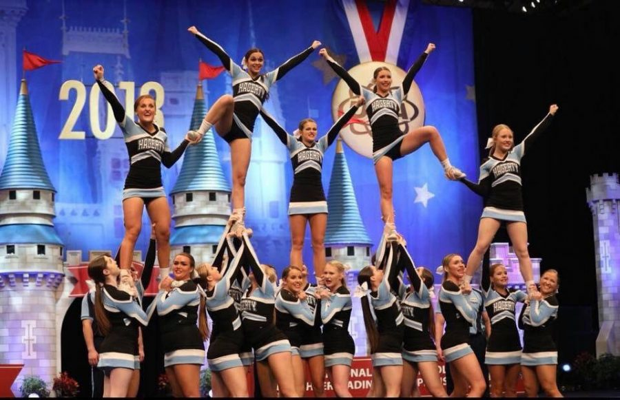 The+varsity+cheerleaders+perform+at+the+National+High+School+Cheerleading+Championship+at+the+ESPN+Wide+World+of+Sports.+The+team+went+on+to+win+the+second+world+championship+in+program+history.