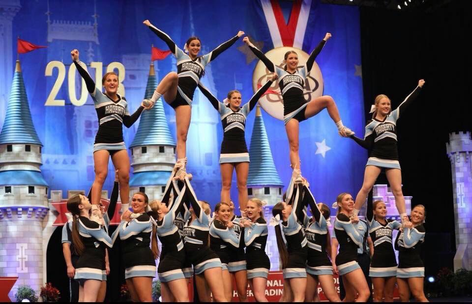 The varsity cheerleaders perform at the National High School Cheerleading Championship at the ESPN Wide World of Sports. The team went on to win the second world championship in program history.