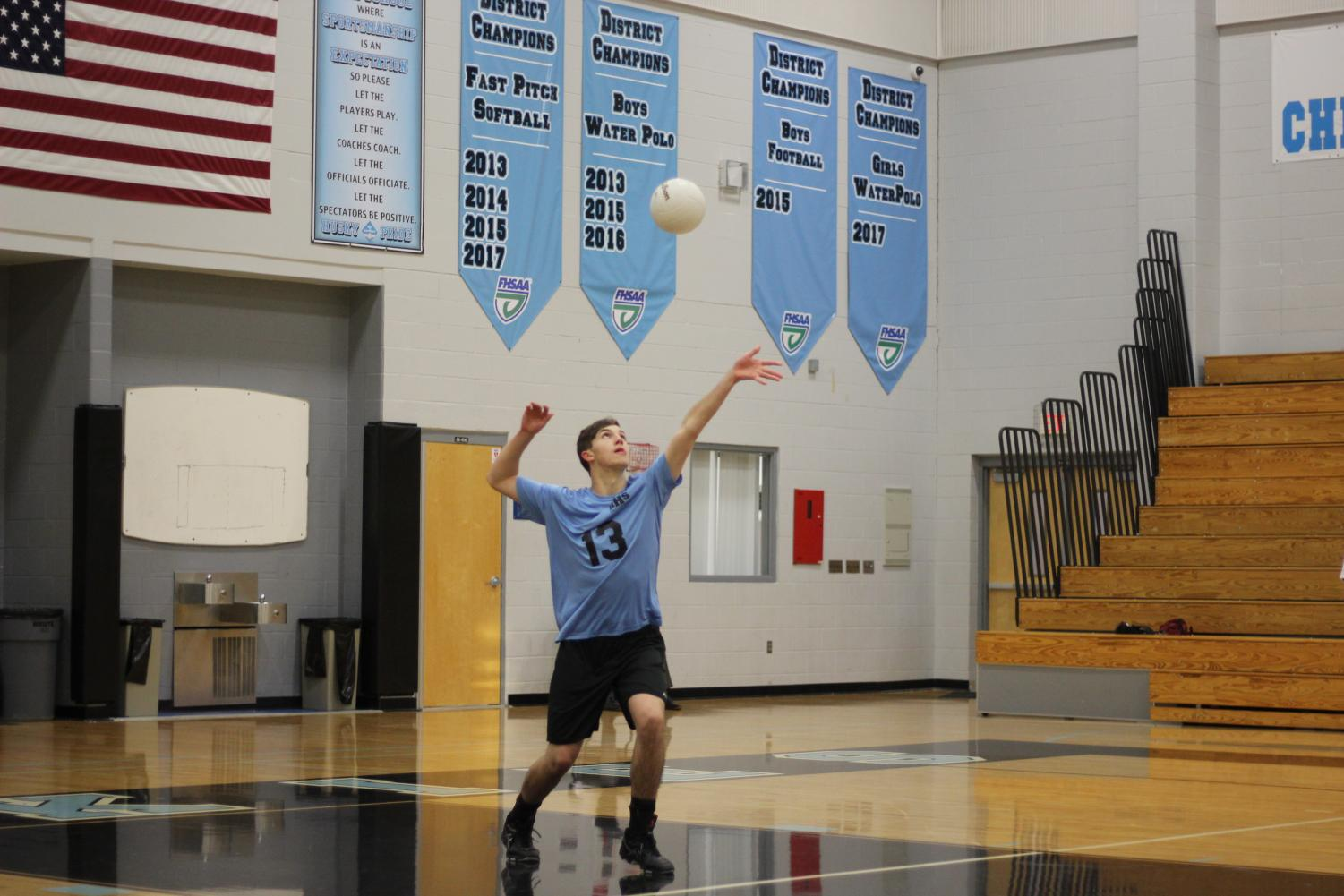 Middle Daniel Heinis serves the ball in the game over Lake Mary. The team won 3-2.