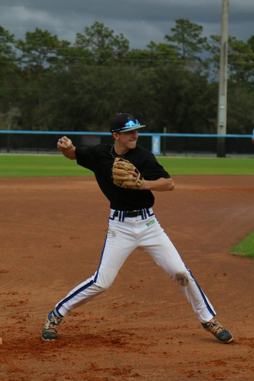 Third baseman Jackson Grabsky throws the ball at baseball tryouts. Grabsky had a hit and two runs in the game over Oviedo.