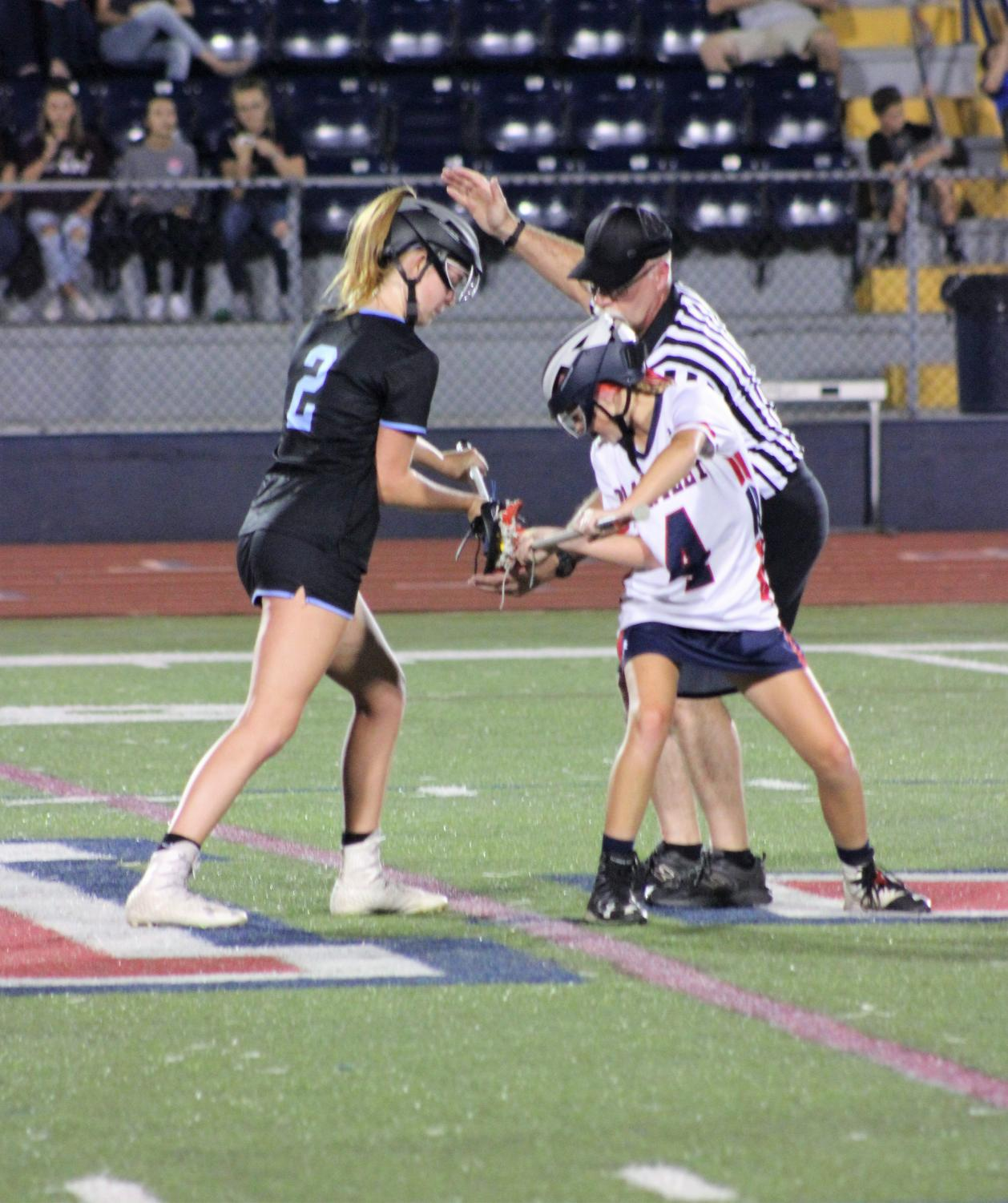 Midfielder Katie Williams sets up for a face off against Lake Brantley. The girls won 12-1, securing their spot in the SAC Championships.