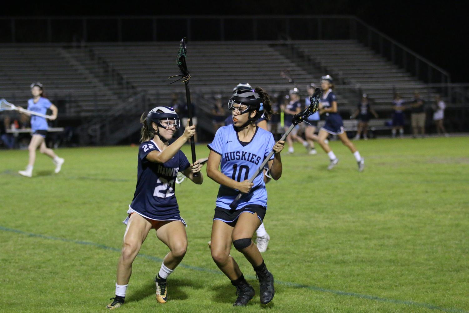 Junior Ashley Rassel works to get around against a Lake Howell player. The game took place on Feb. 27 at the Sam Momary Stadium and resulted in a 19-1 win.