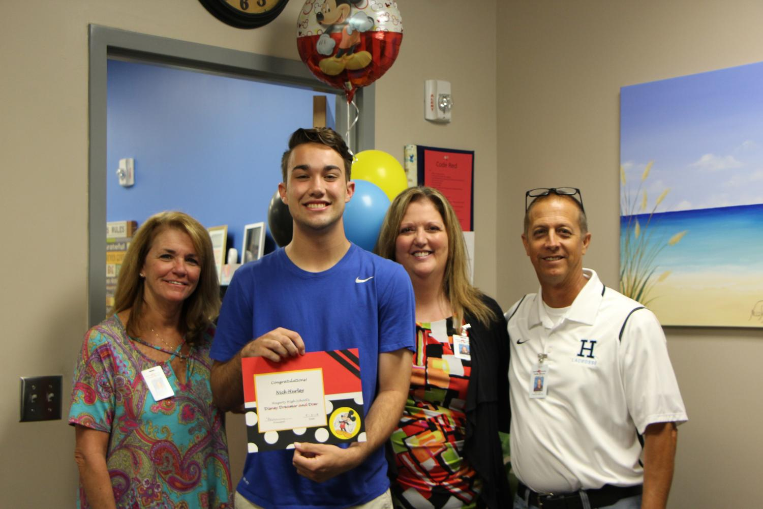 Senior Nick Hurley poses with Student Services and Administration. He won the Disney Dreamer and Doer award.