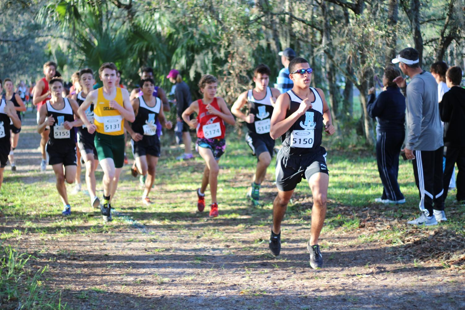 Senior Anthony Del Rosario nears the end of one of his cross country races. He picked up this sport in his junior year after he had too many concussions to continue on in football.