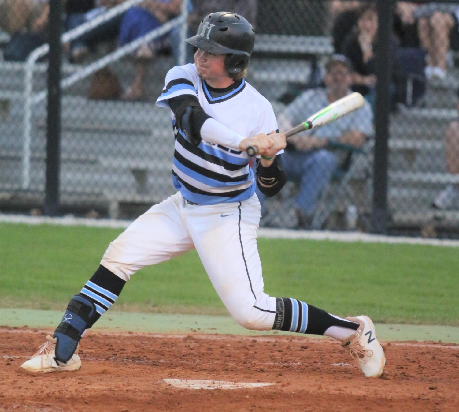 Catcher Robby Post takes a swing at a pitch during the team's home game against Lake Howell on April 4. The team went on to win the game, 9-5.