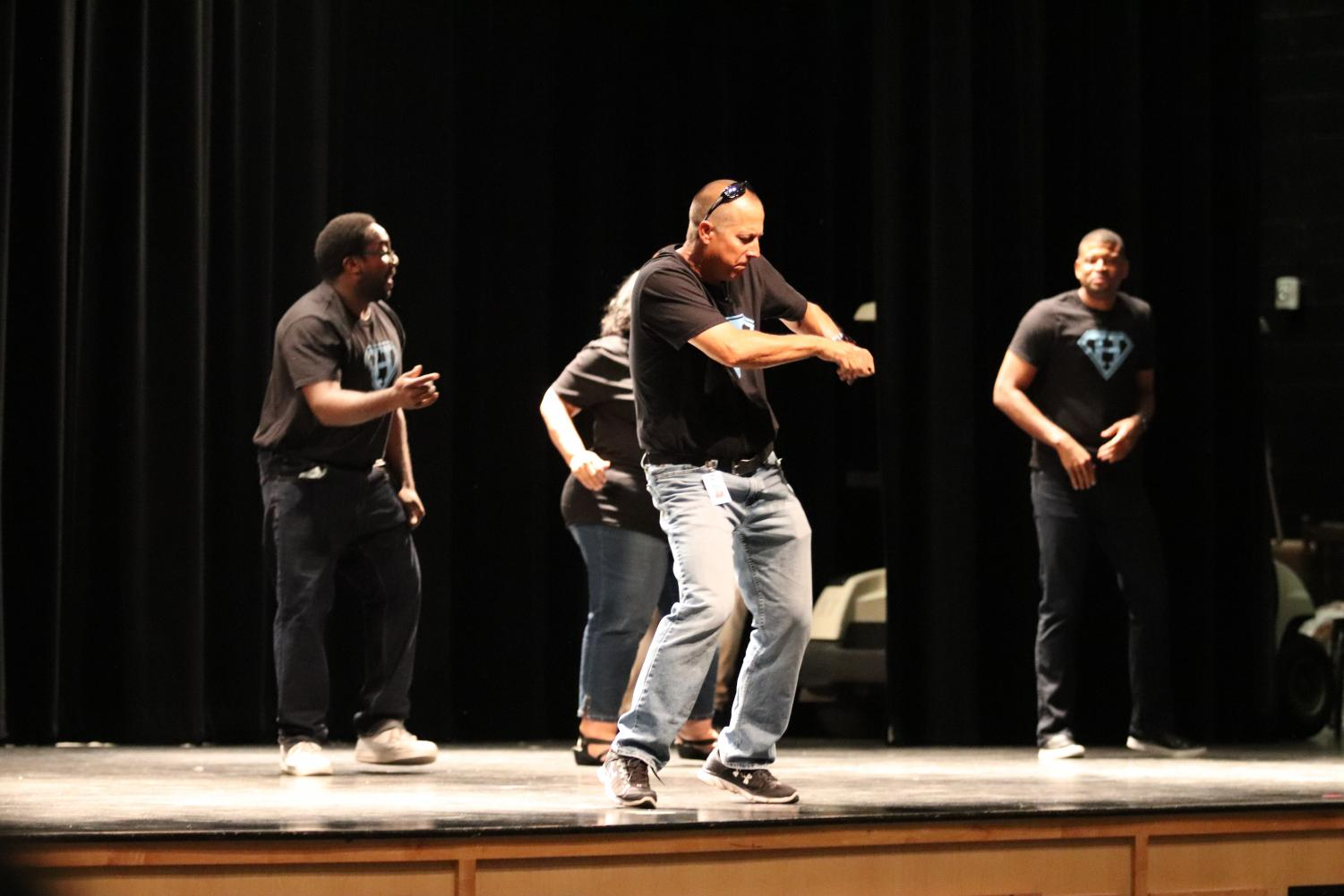 Athletic Director Jay Getty dances at the senior skit. Relating to students is only one of his many attributes that contributed to this award.