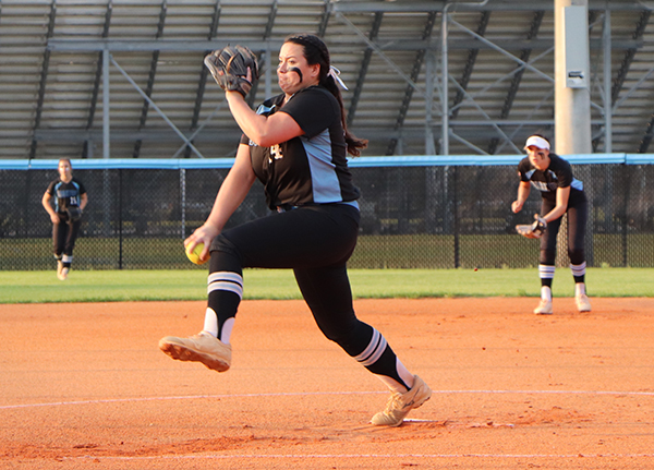 Senior Ashley Worrell pitches against Winter Springs in the district championship on Thursday, April 26. The team lost 8-6, but has a chance to play Winter Springs again in the second round of the regional playoffs.