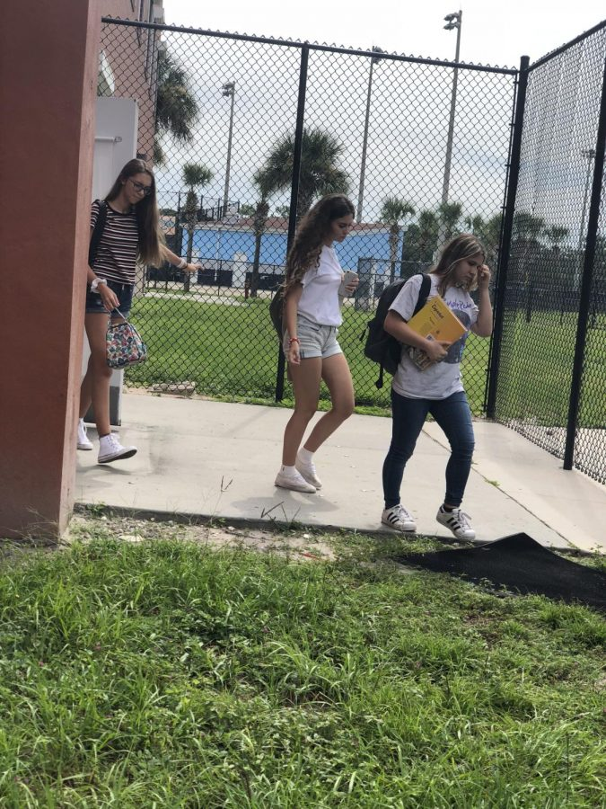 Sophomores+Viviana+Nute%2C+Erena+Loria+and+Maria+Raptis+walk+out+of+their+classroom+before+lunch.+Displayed+in+the+photo+is+the+newly+placed+fence+for+student+safety.+