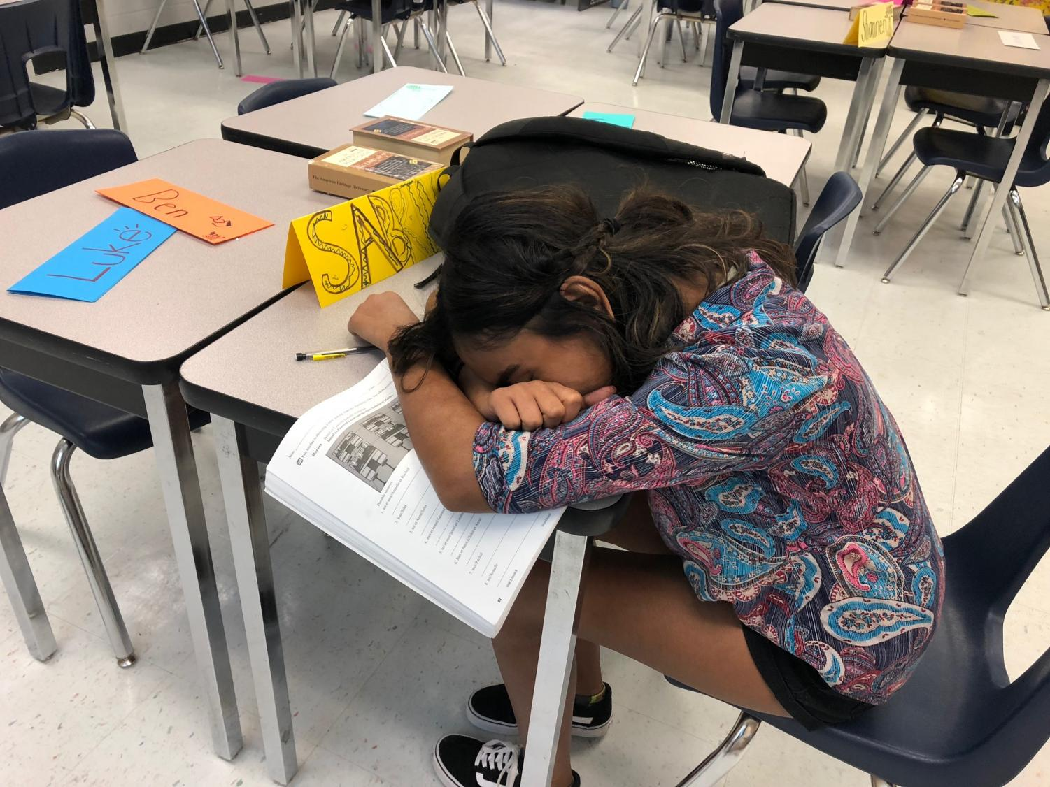 Sophomore Sabrine DeSilva takes a power-nap at the end of class. After a long day, she likes to recharge her energy.