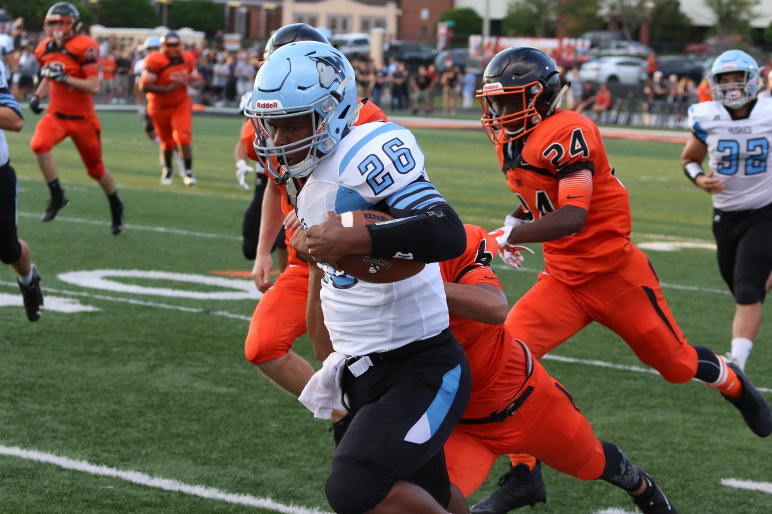 Running back Jordan Gilbert stiff arms a tackler during last year's game against Oviedo. The varsity team lost 48-27. This year's game will be on Sept. 7 at 7 p.m.