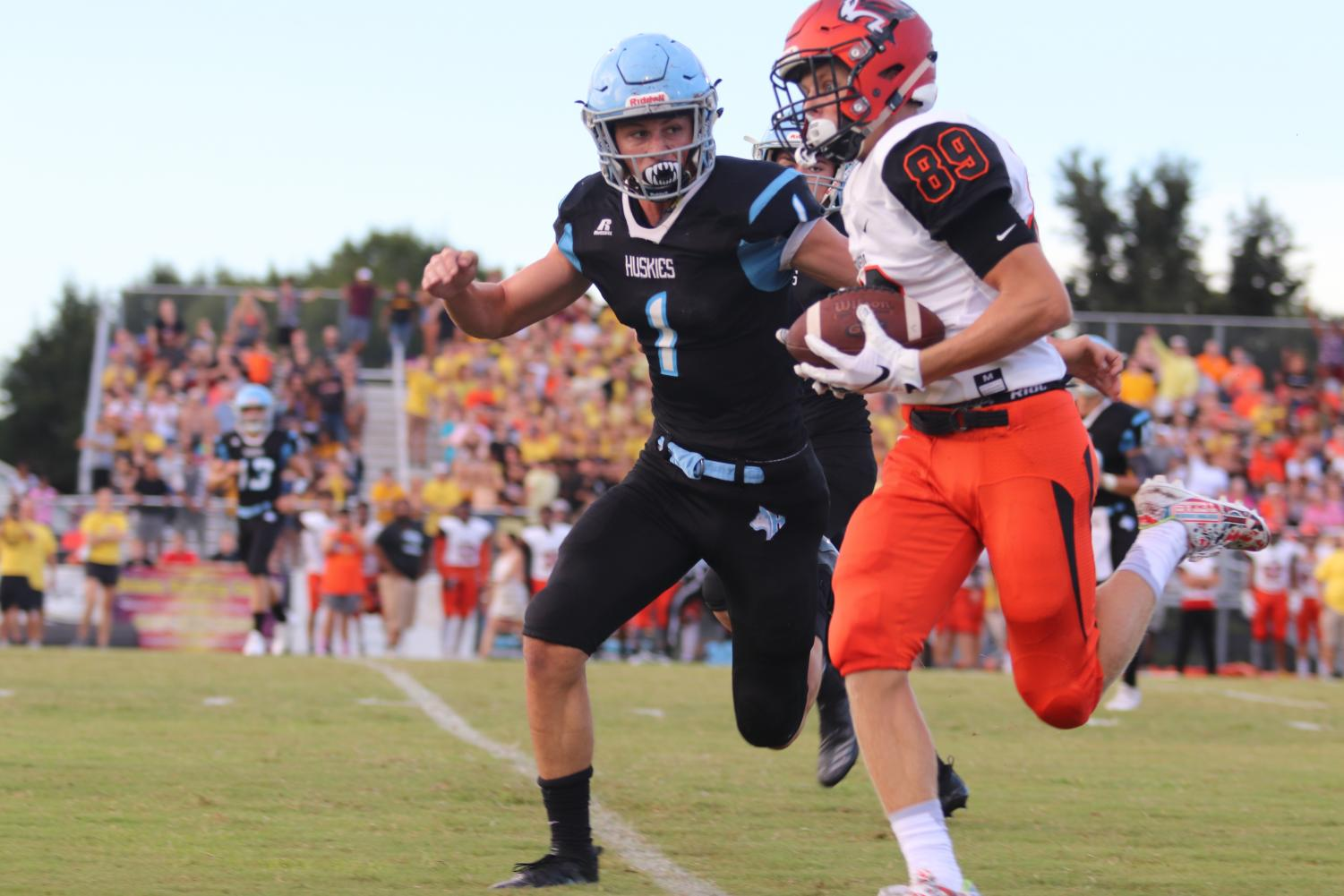 Defensive back Ian Watts goes for a tackle on Oviedo receiver Matt Rucker. Though Watts kept the team in the game with good defense and a 97-yard kickoff return for a touchdown, the varsity team lost to the Lions, 44-23.