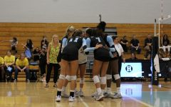 The team rallies after a point was scored. Hagerty lost 3-0.