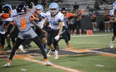 Wide receiver Porthos Sattler blitzes on the Oviedo quarterback. The JV team lost to Oviedo, 27-14