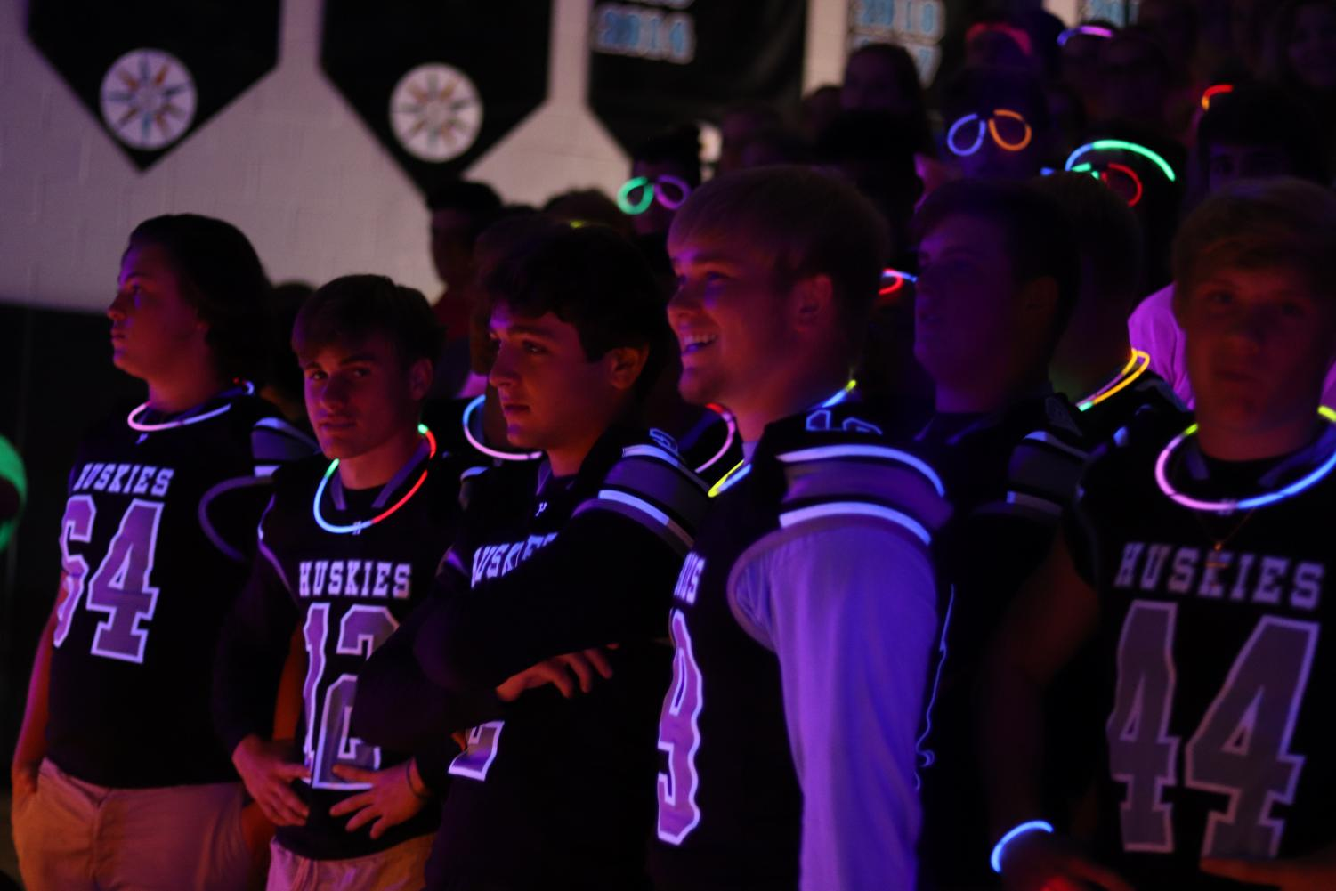 Varsity football players during the glow-in-the-dark pep rally
