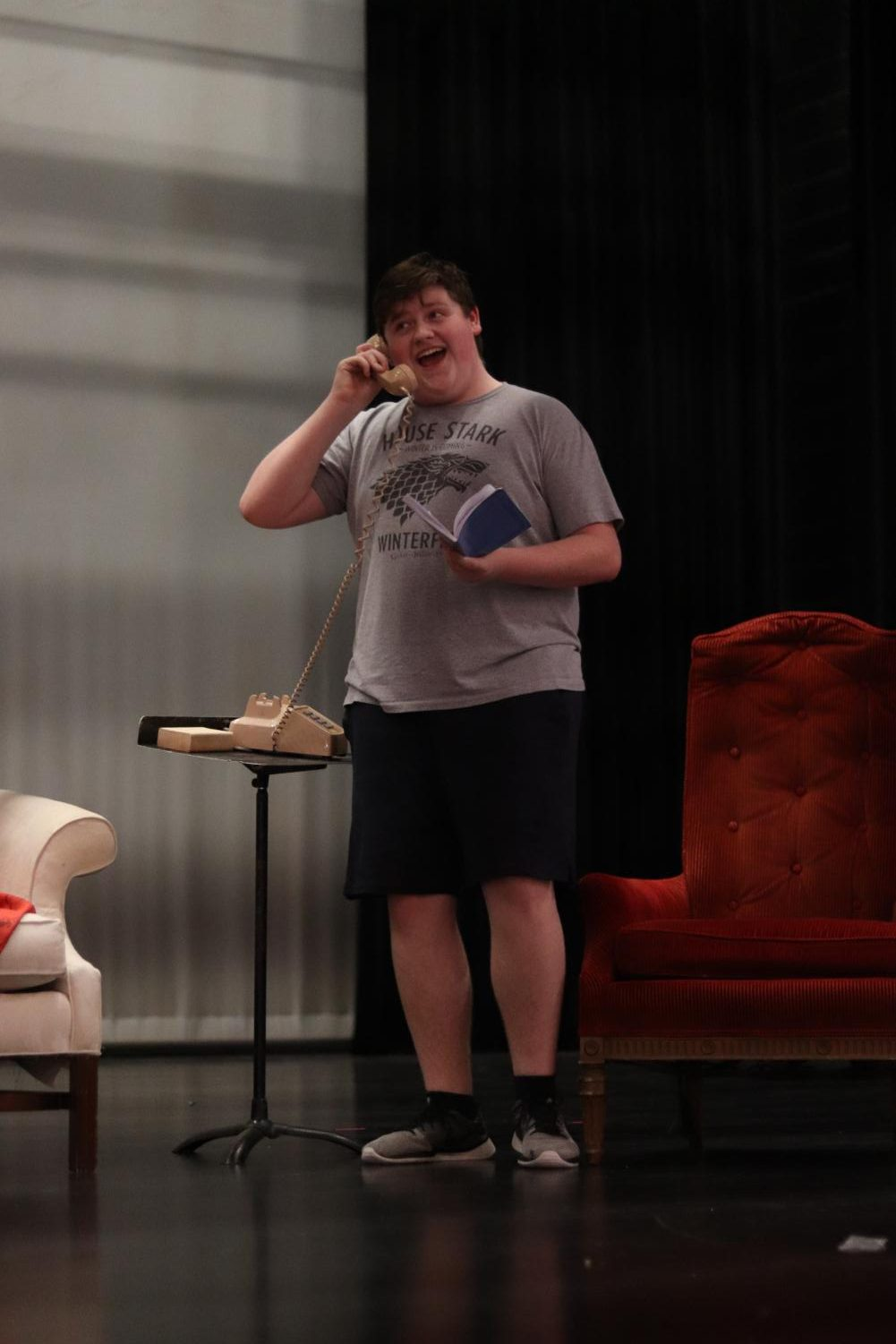 Male lead, Oscar, played by junior Jake Lippman, rehearses the scene where his daughter and ex-wife call him during a poker game.