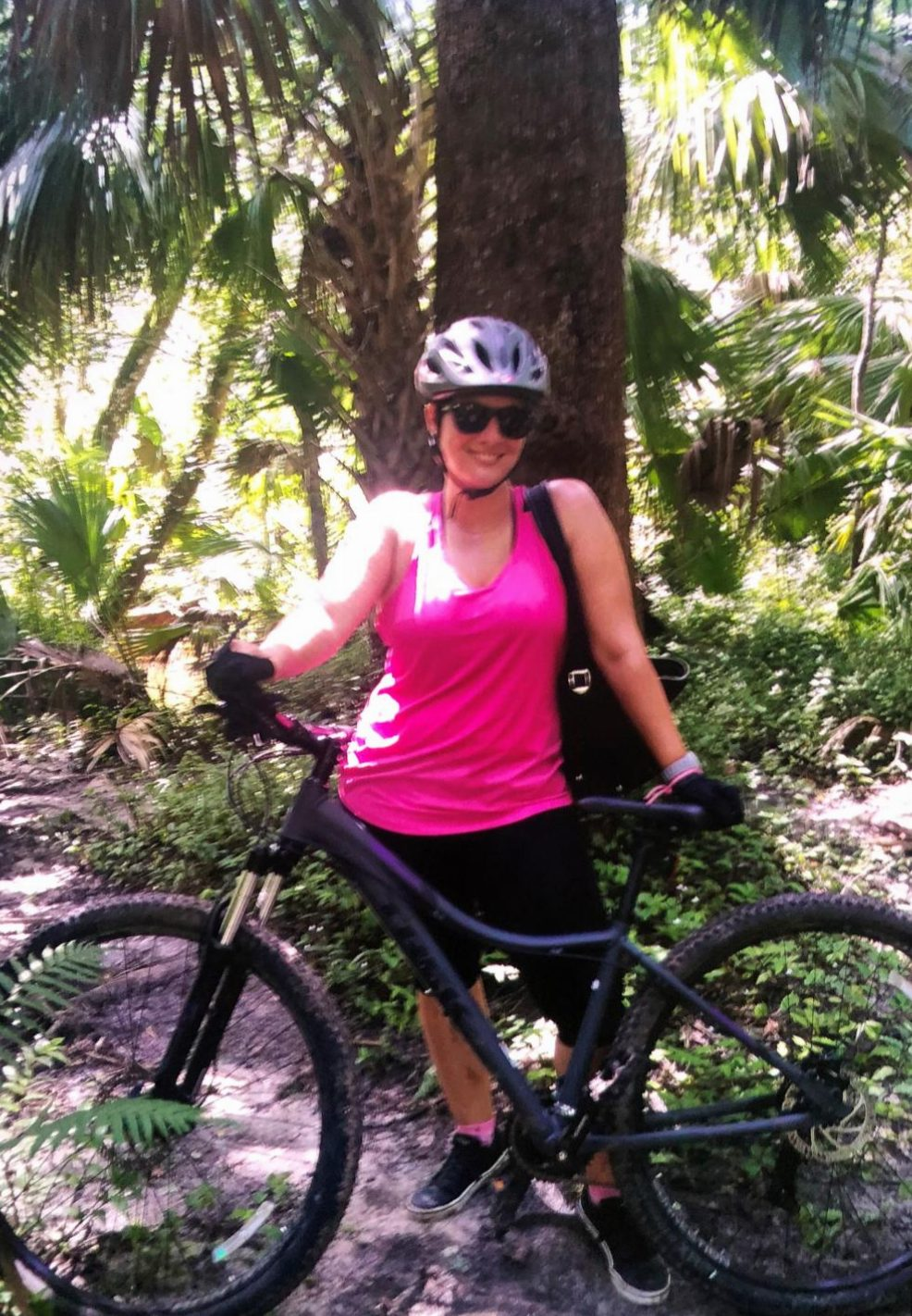 Joanie Rodriguez poses with her new mountain bike. Rodriguez started mountain biking during the summer with her friend. As a team, they would go off-trail mountain biking every weekend.