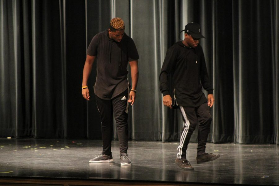 Senior Nasir Roberts and junior Josiah Wright perform one of their dance moves at the talent show. These moves were similar to that of a robot.