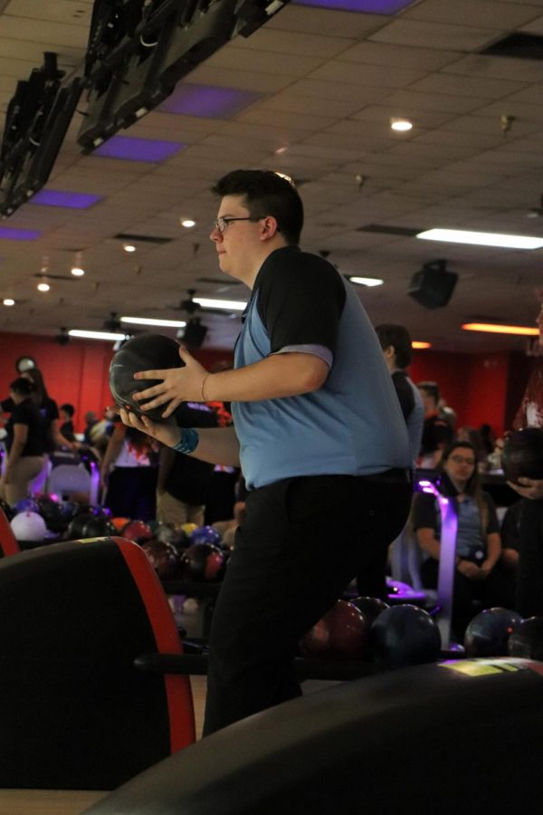 Senior Logan Furlong with his first bowl during a match against Crooms.