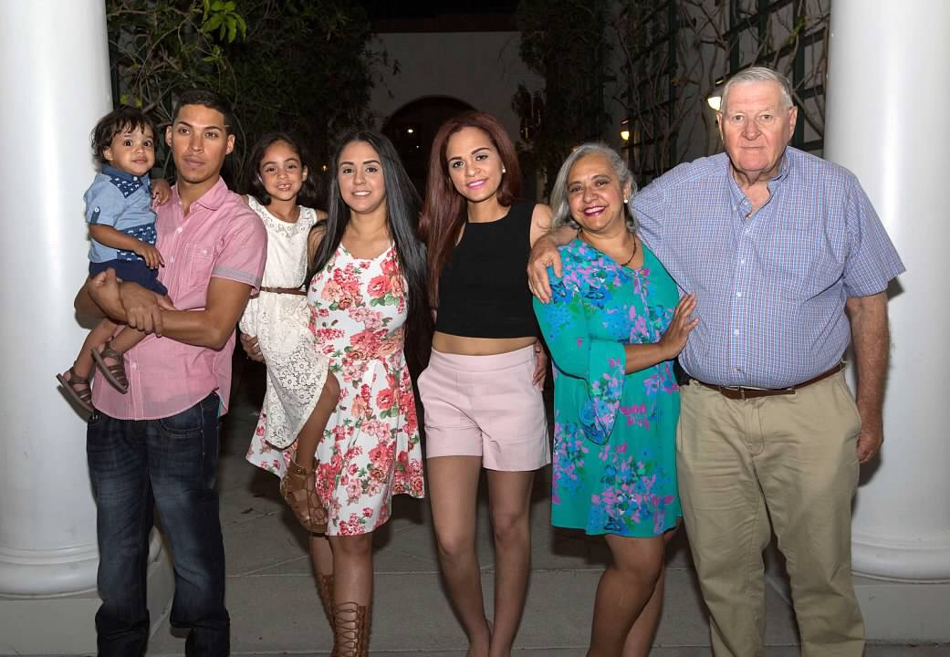 Custodian Vanessa Benoit poses with her family at one of their family events. At these gatherings, they typically dance bachata.