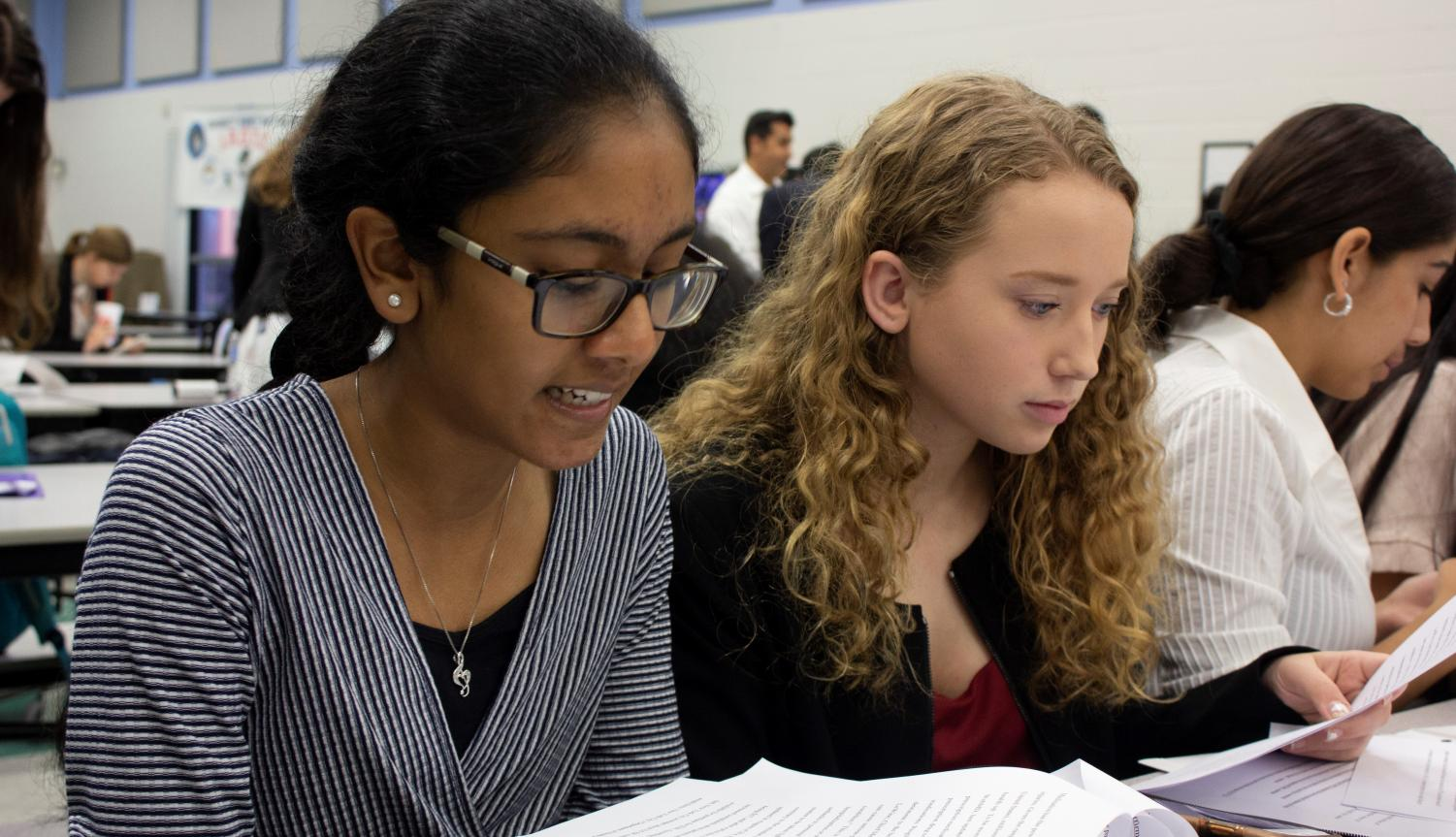 Sophomores Emily Grossenbaugh and Roshna Cherugail practice their case work before the tournament.  Grossenbaugh and Cherugail were partners in the public forum and received first place in the division.