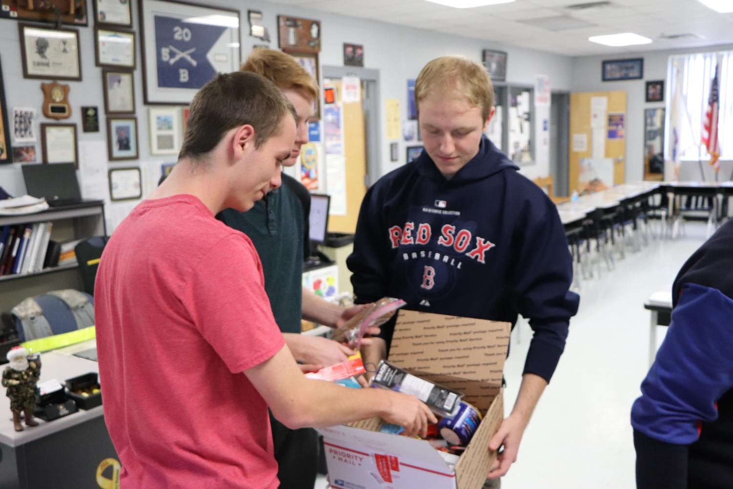 JROTC cadets package supplies for soldiers as a part of this year's Operation Care Project. Items were collected to send for Christmas.