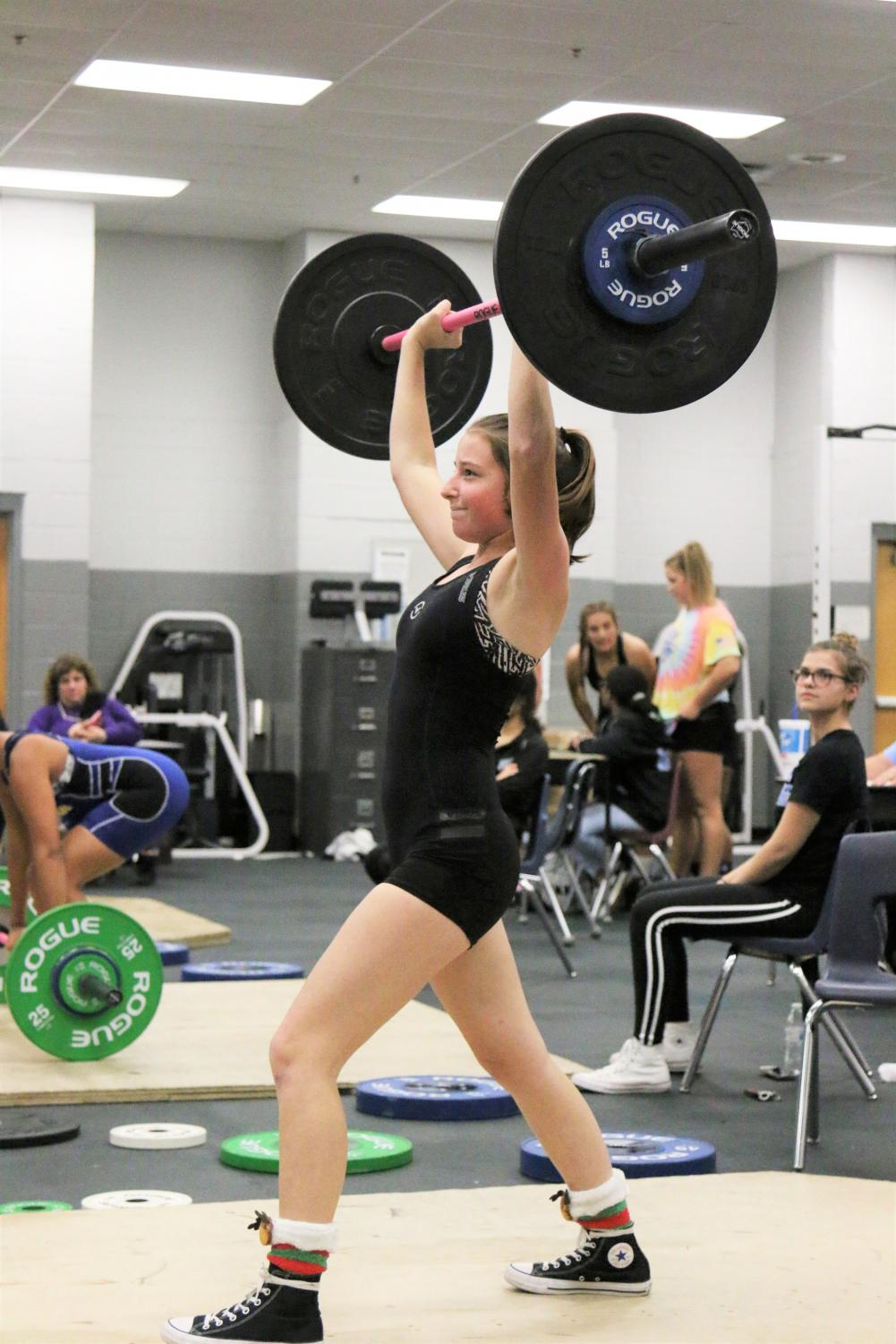Sophmore Daryn Miller on her second clean and jerk attempt during a match against Lyman.