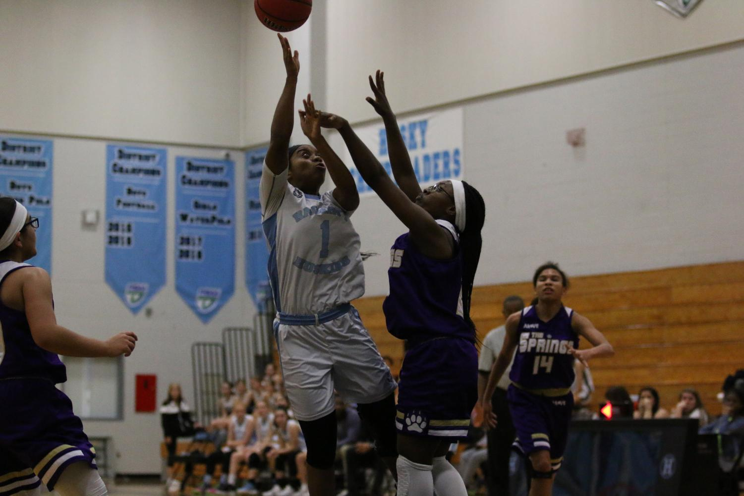 Forward Aryann Johnson goes up for a layup against Winter Springs. The team won and began the season 5-0.