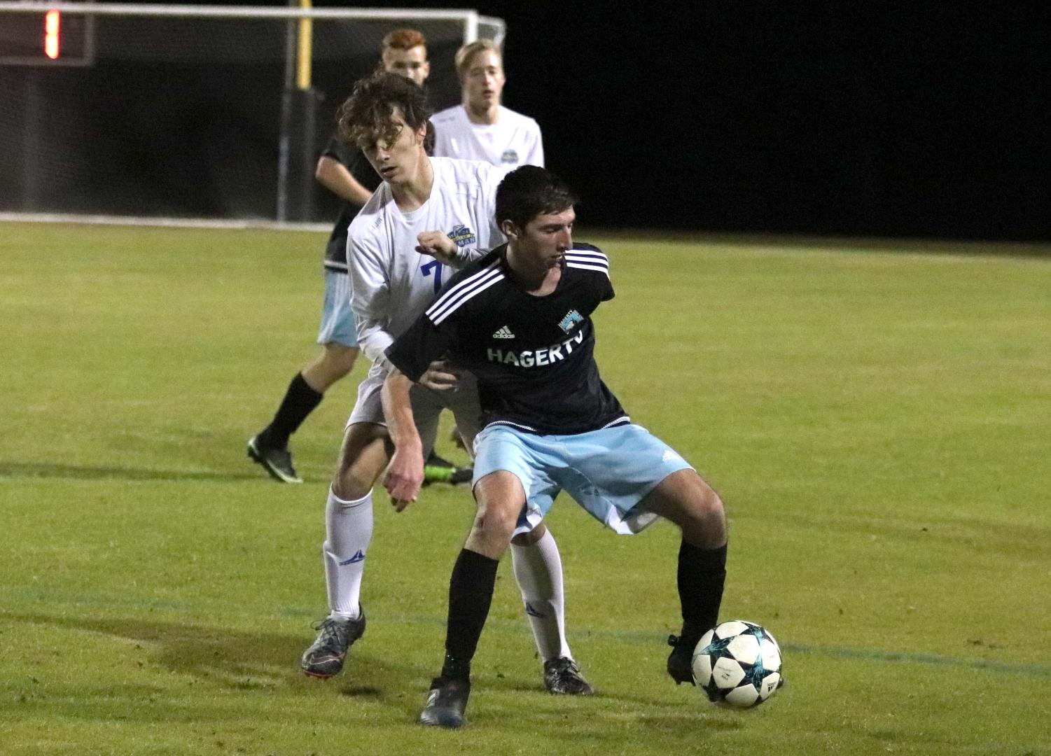 Outside midfielder Evan Sorace maintains possession against a Lyman defender. Sorace scored on a penalty kick to help the team to a 4-0 shutout.